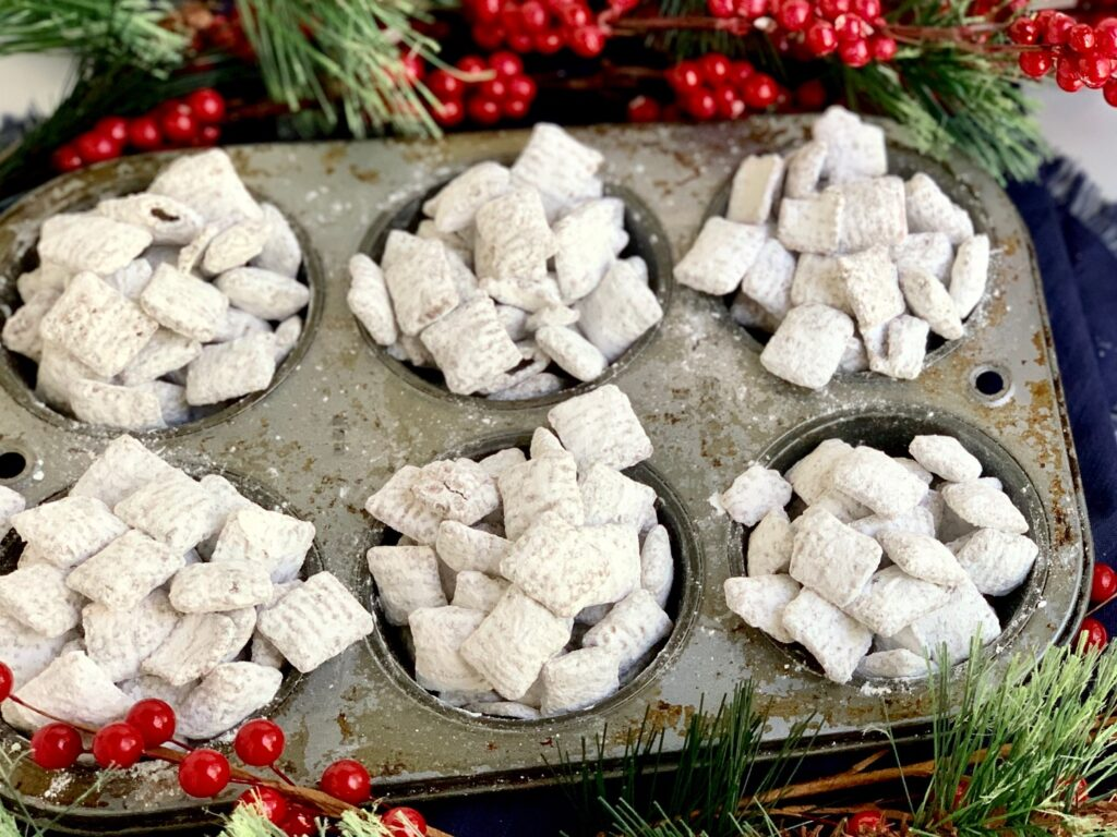 A muffin tin full of puppy chow