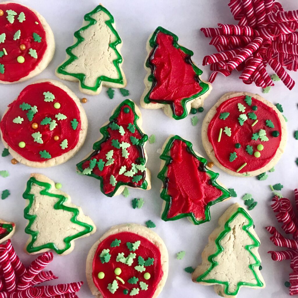 Different size Christmas themed sugar cookies