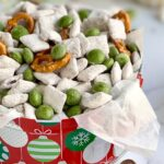 A holiday tin filled with homemade puppy chow, pretzels twists, and No Whey Peppermint No No's