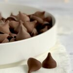 A large white serving platter filled with chocolate kisses