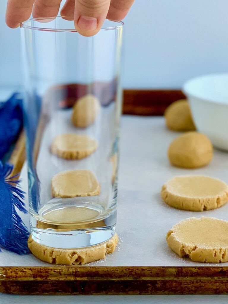 A glass on top of a cookie-- flattening it