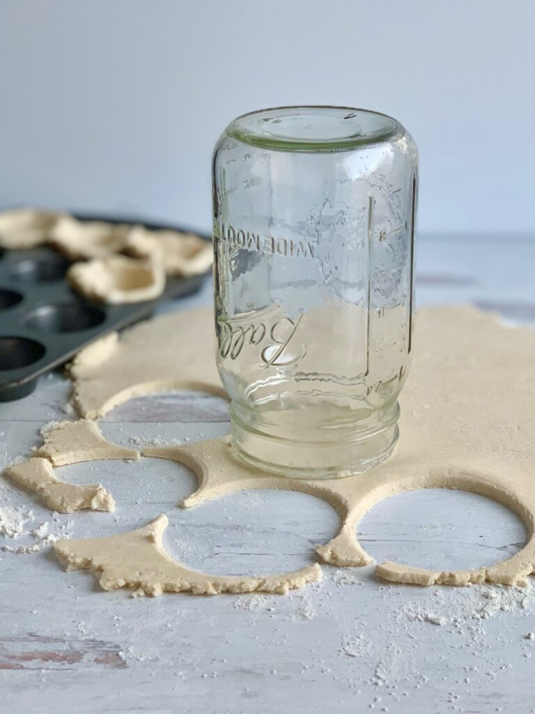 a large glass jar upside down cutting out round mini crusts