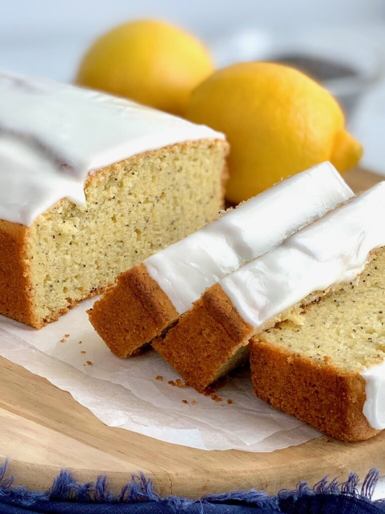 Large slices of lemon poppy seed bread with a glaze.