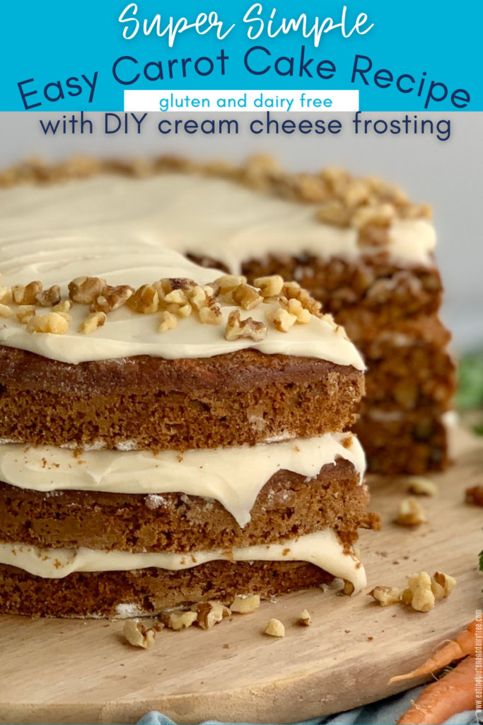 A 3 tiered carrot cake with a white cream cheese frosting in-between each layer and on top with nuts. A slice has been cut out of the cake  so you can see the layers inside too.