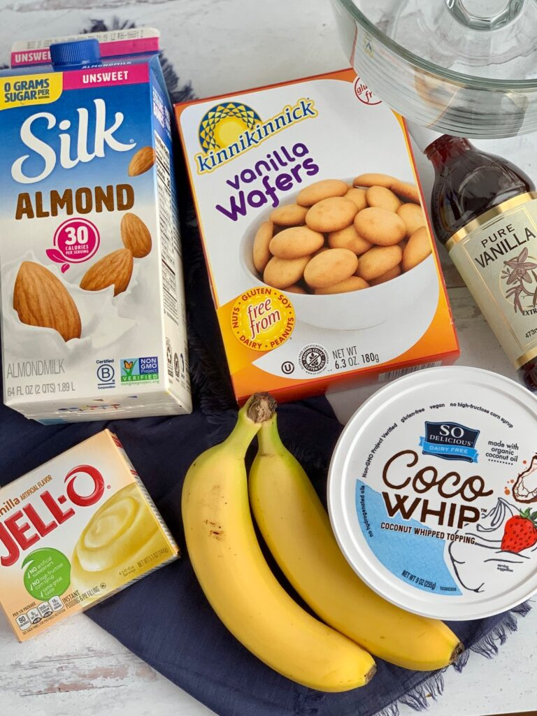 The ingredients for this recipe-- dairy free milk, vanilla wafers, vanilla extract, 2 bananas, Instant Jell-O, and Cocowhip on the kitchen counter.