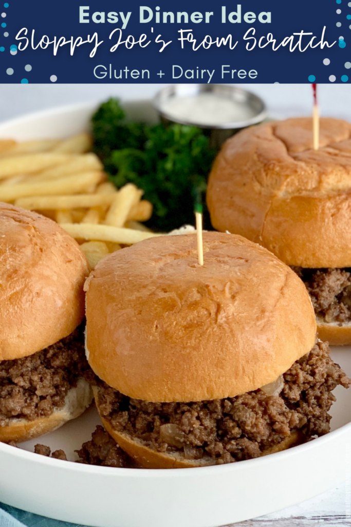 A white platter with 3 sloppy joes- a meat mixture in a bun with French fries on the side.