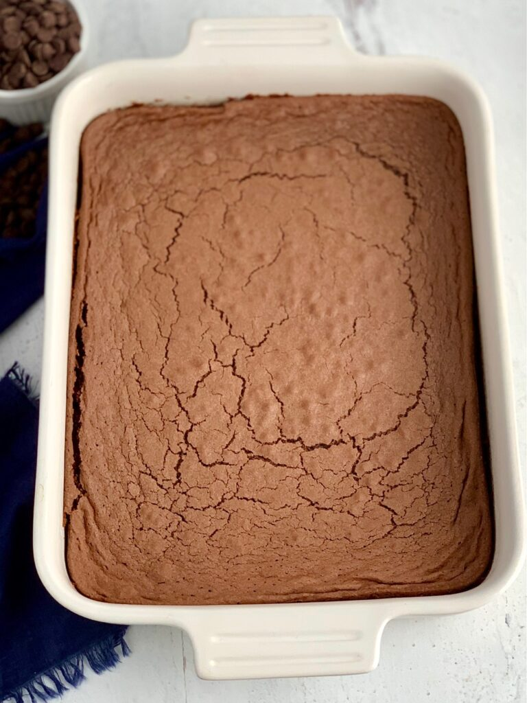 A baked chocolate brownie mix in a white 9X13-inch baking pan