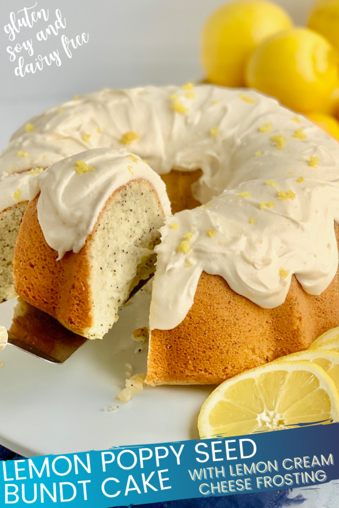 A lemon poppy seed bundt cake topped with a creamy lemon cream cheese frosting on a cake plate. A cake server is lifting a big slice off of the plate.