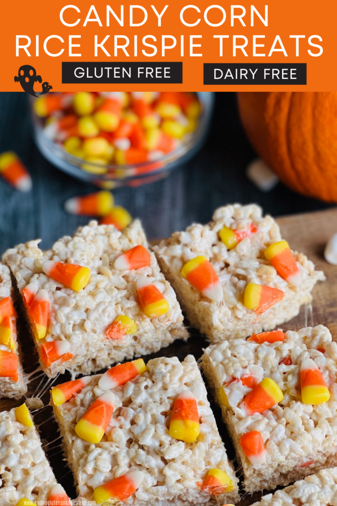 Rice krispie cereal coated in melted marshmallow with candy corns on top cut into squares.